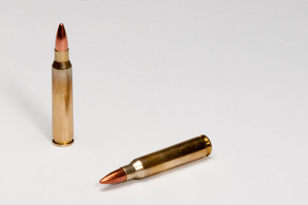 A white backfround and two 223 cartridges 写真素材