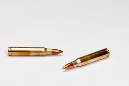 A white background and two 223 cartridges Stock Photo