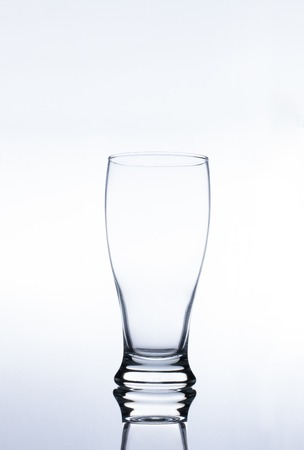 Clear Pilsner Glass on white background