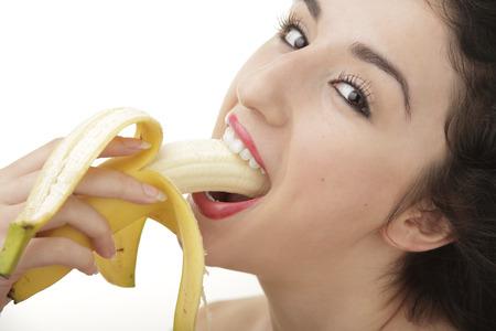 Sexy woman eating banana photo