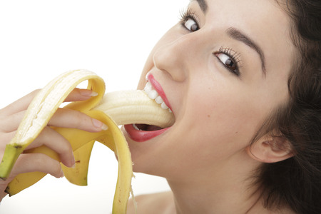 sucking: Sexy woman eating banana
