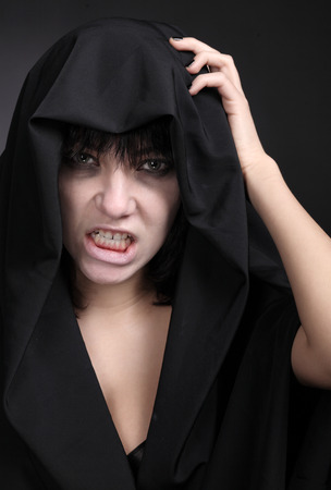 Scary woman with a pale face photo