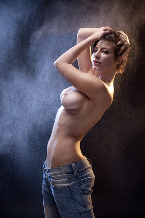 Wet sexy topless woman with jeans