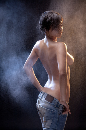 Wet sexy topless woman with jeans photo