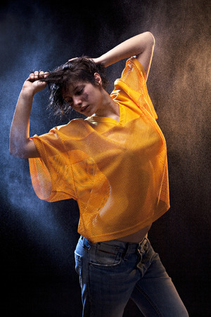 Wet sexy woman with yellow football shirt photo