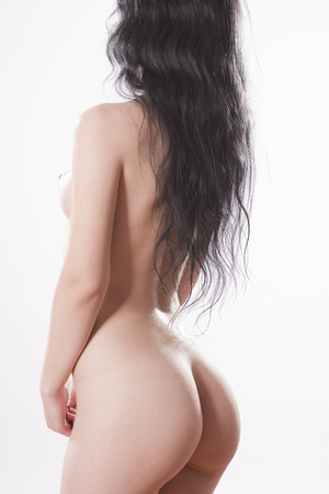Beautiful female naked body in the back with long hair. Isolated on white. Studio photos.