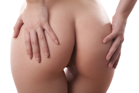 nude: Beautiful woman part of body in the back. Buttocks. Isolated on white. Studio photos. Stock Photo