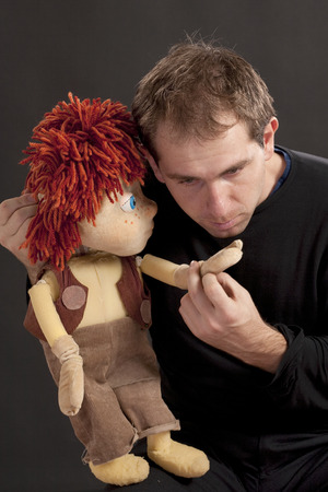 Portrait of a actor and puppet. Studio shot. Black background Stock Photo