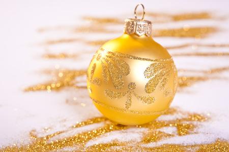 studio shot: Golden Christmas toy whit handmade decoration. Spilled glitter. Studio shot Stock Photo