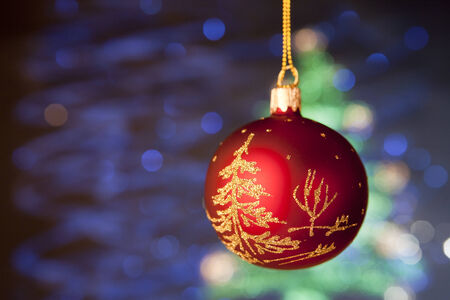 Beautiful red cristmas toy with handmade decoration. Blurрed blue background photo