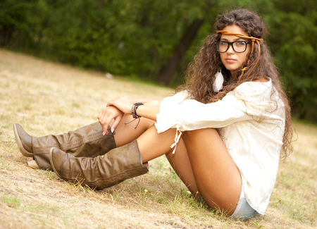 Beautiful hippie girl with rope in the park. Outdoor portrait. photo