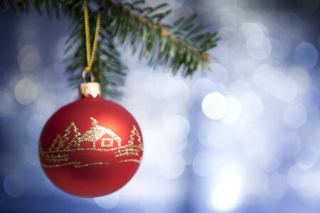 cristmas: Beautiful red cristmas toy with handmade decoration. Blurрed blue background