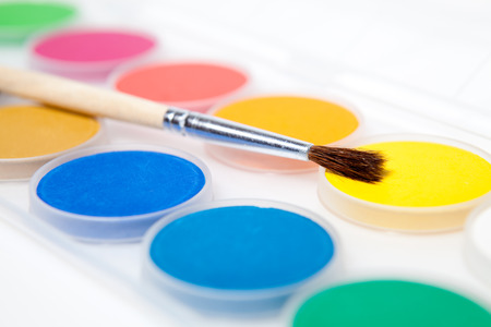 Watercolors - paint box. White background. Studio shot photo