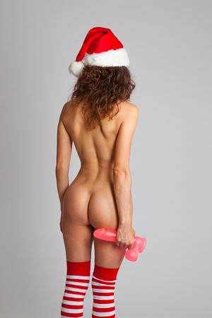 nude babe: Sexy naked Santa Helper woman with dildo. Studio shot Stock Photo