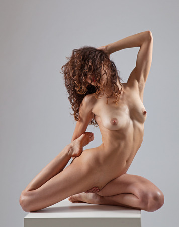 Sexy nude woman doing yoga exercises