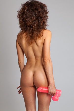 nude babe: Sexy naked woman in back holding dildo