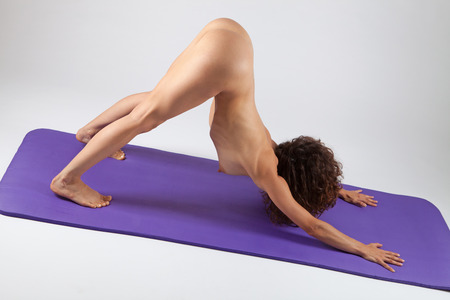 nude breasts: Sexy nude woman doing yoga exercises