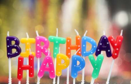 Candles in the form of letters a happy birthday. Stock Photo