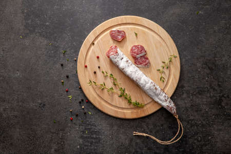 sausage fuet smoked dried dried salami meat on the table breakfast breakfast outdoor top view food background rustic image Stok Fotoğraf
