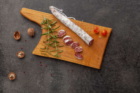 sausage fuet smoked dry-cured salami meat on the table meal snack outdoor top view food background rustic image Stok Fotoğraf