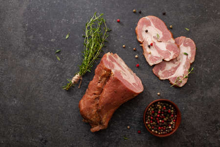 Sliced smoked gammon addition of fresh herbs and aromatic spices. Natural product from organic farm, produced by traditional methods
