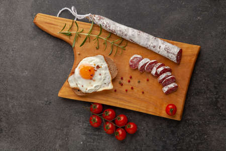 Sausage fuet smoked dry-cured salami meat on the table meal snack outdoor top view food background rustic image.