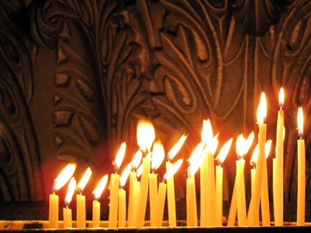Candles in the Church of the Holy Sepulchre, Jerusalem                                Stock Photo - 6090564