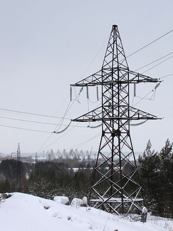 poling: High-voltage power transmission lines in the winter forest                               Stock Photo