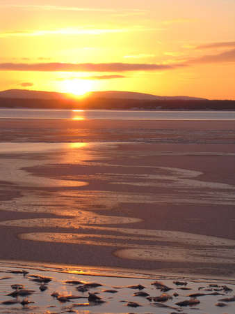 Sunset on the ice-covered White sea                                photo