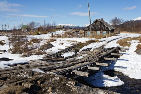 unfit: Old wooden bridge on sunny spring day