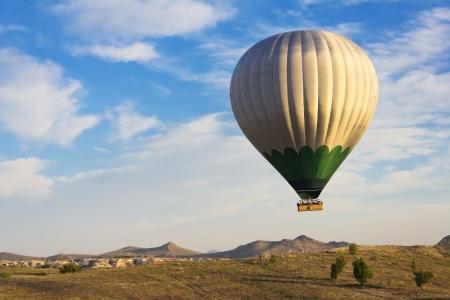 Hot air balloon flying over Cappadocia, Turkey Stock Photo - 14392289