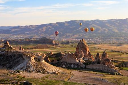 Hot air balloon flying over Cappadocia, Turkey photo