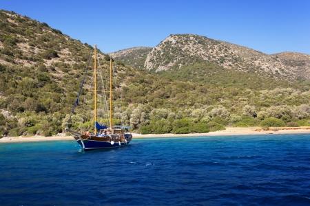 Yacht at anchor in a beautiful bay near Bodrum, Turkey Stock Photo