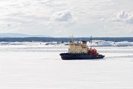snow break: Icebreaker in the White Sea, Russia Stock Photo
