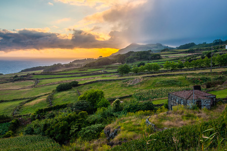 agriculture azores: Oncoming afternoon rain at the coast of Sao Jorge - Azores- Portugal. Stock Photo