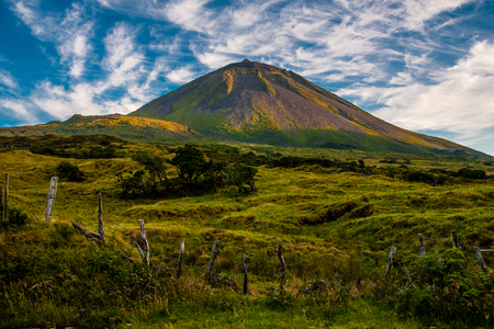 agriculture azores: The warm coloured evening sun gracing the volcanic mount Pico on the island of Pico-Azores-Portugal. Stock Photo