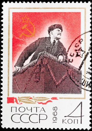 dictator: Stamp with the image of the dictator (Lenin) on a tribune.
