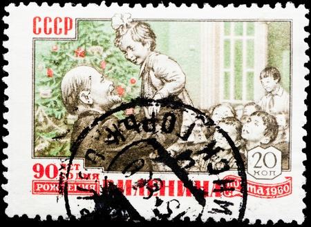 communists: Postal stamp. Lenin is holding a little girl.