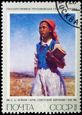 kirgizia: Postal stamp. Portrait of the girl with books against the blue sky.