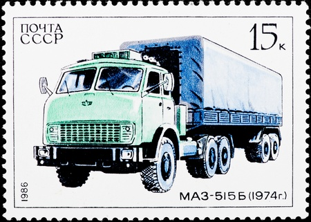 Postal stamp. The green auto truck on a white hum