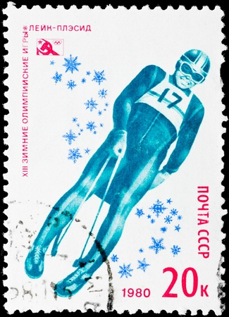 toboggan: Postal stamp.  Toboggan, 1980. XIII winter Olympic plays. Lake Placid