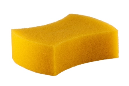 Yellow sponge on a white hum. Stock Photo - 10041706