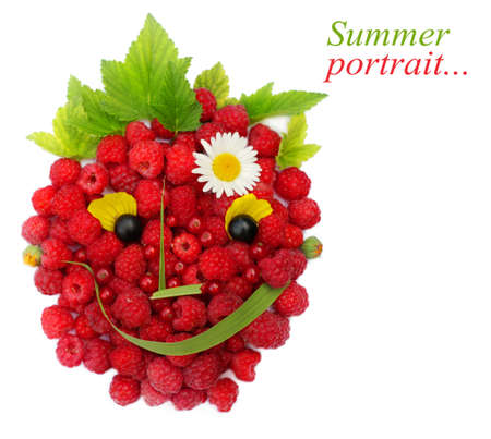 Summer portrait made from berries, leaves and flowers. photo