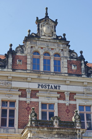 Facade of the old post office in the town Loebau, Saxony, Germany
