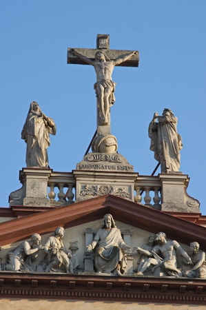 The Roman-Catholic cathedral of the Divine Savior in Ostrava, a building from the 19th century. A statue of the Calvary scene in the gable of church.