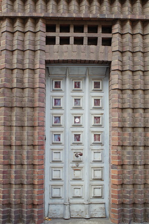 Old door in brick portal