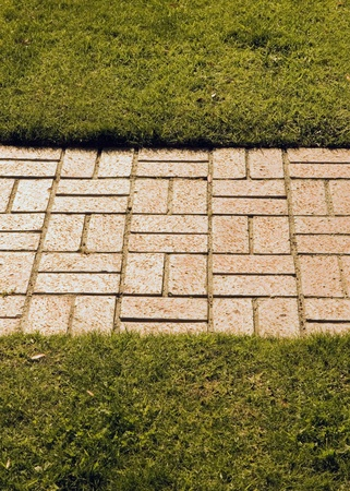 Red brick road across the grass