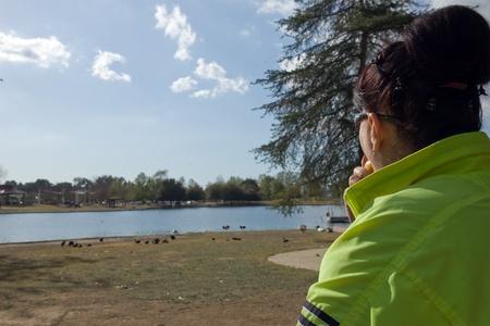 Woman looking at the lake