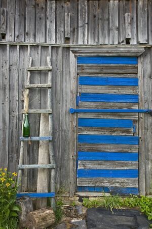 Weathered wall of old barn with a old ladder       photo