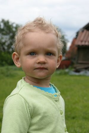 Baby looking ahead Stock Photo